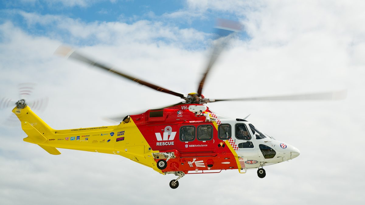 side view of westpac rescue helicopter flying