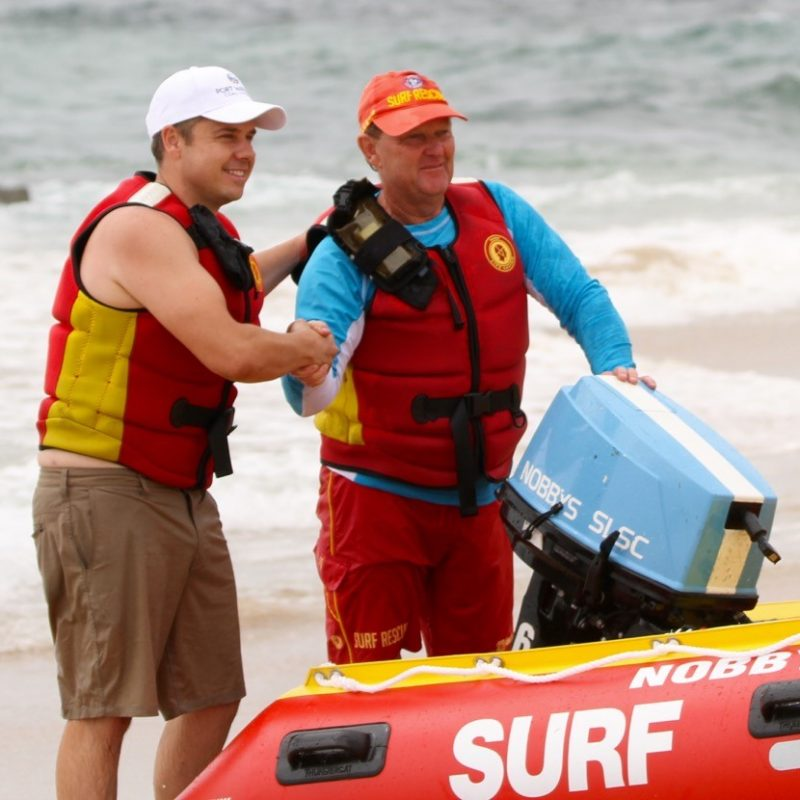Members of Nobby's SLSC shaking hands