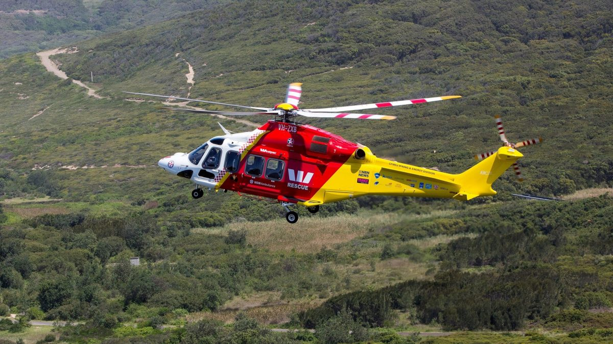 close up of westpac rescue helicopter flying over bushland