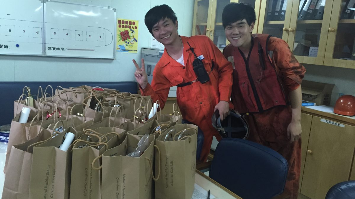 employees with gift bags at mission to seafarers newcastle