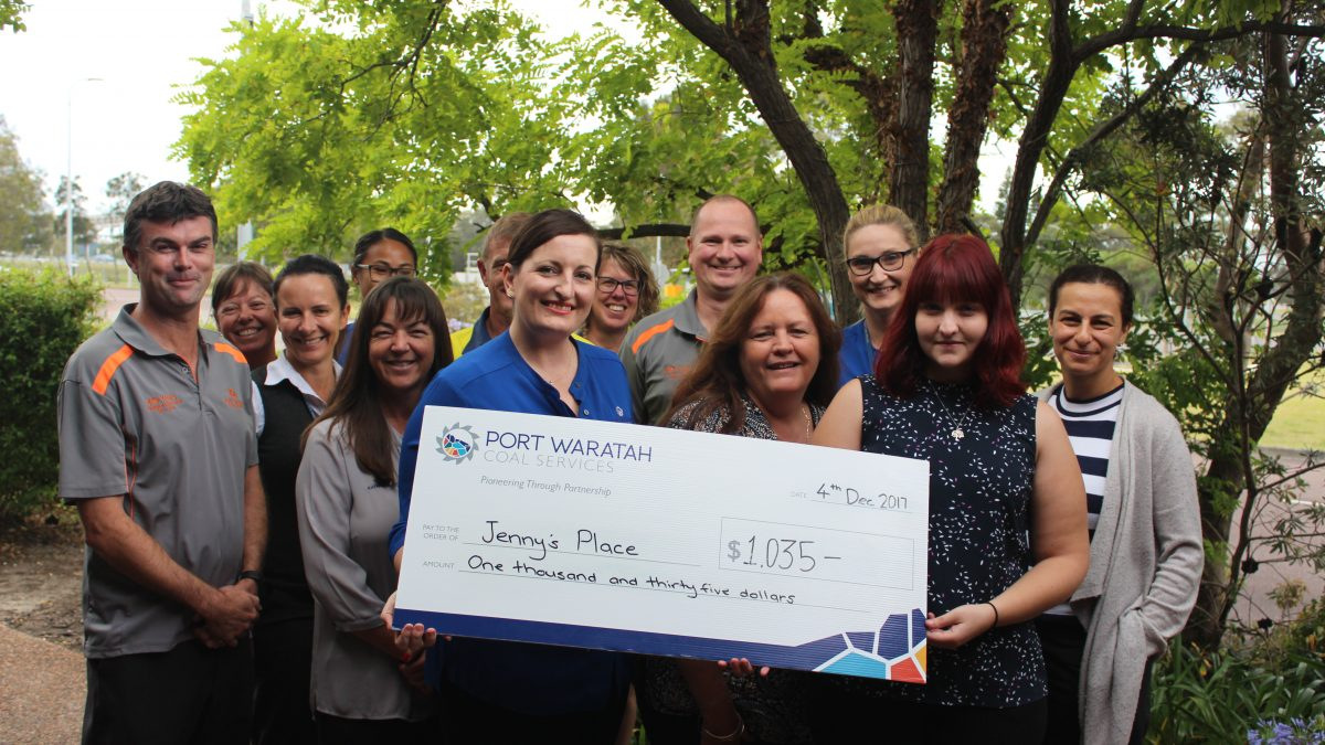 Jenny's Place group photo with cheque