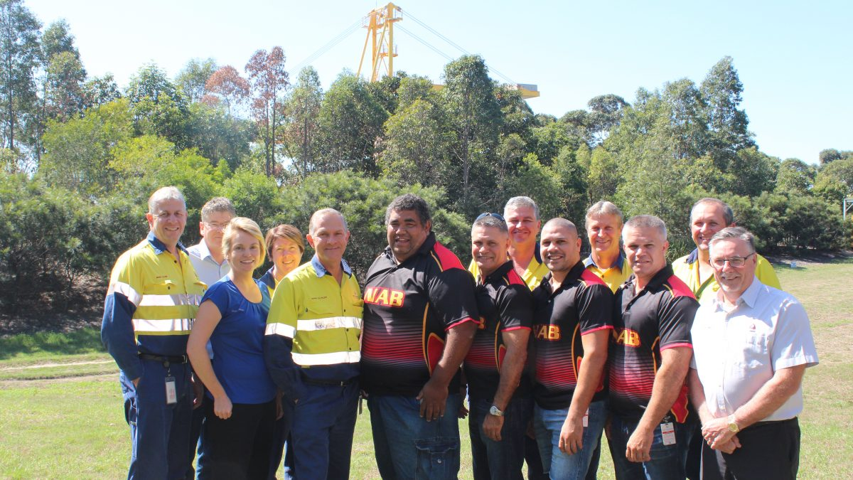 Koori Knock-out team and Port Waratah Coal Services employees