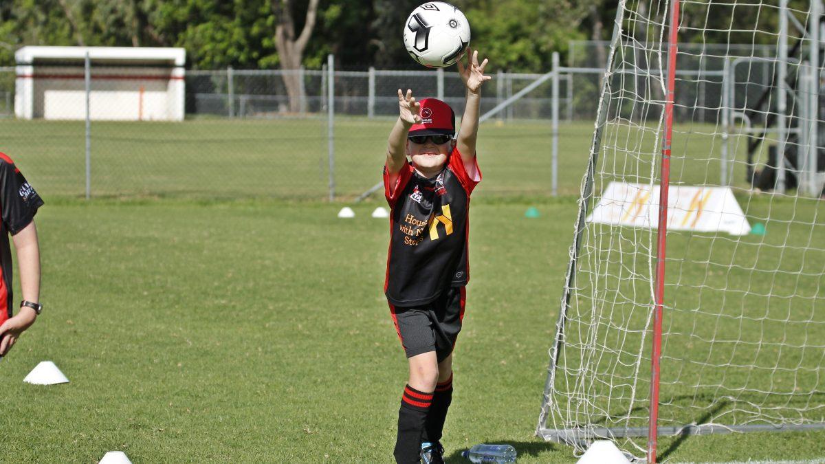 arnetts football teammate catching ball