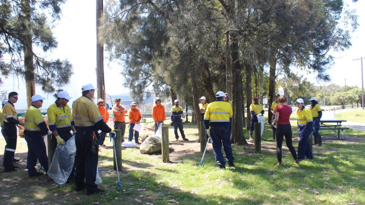 Port Waratah employees getting garbage collection instructions