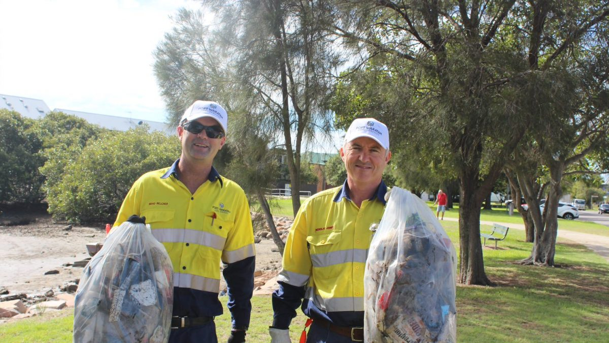 Port Waratah employees with full bags of garbage