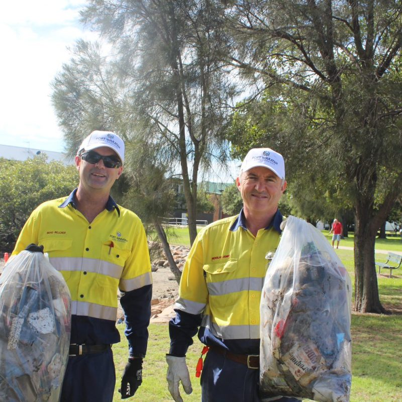 Port Waratah employees with full bags of garbage