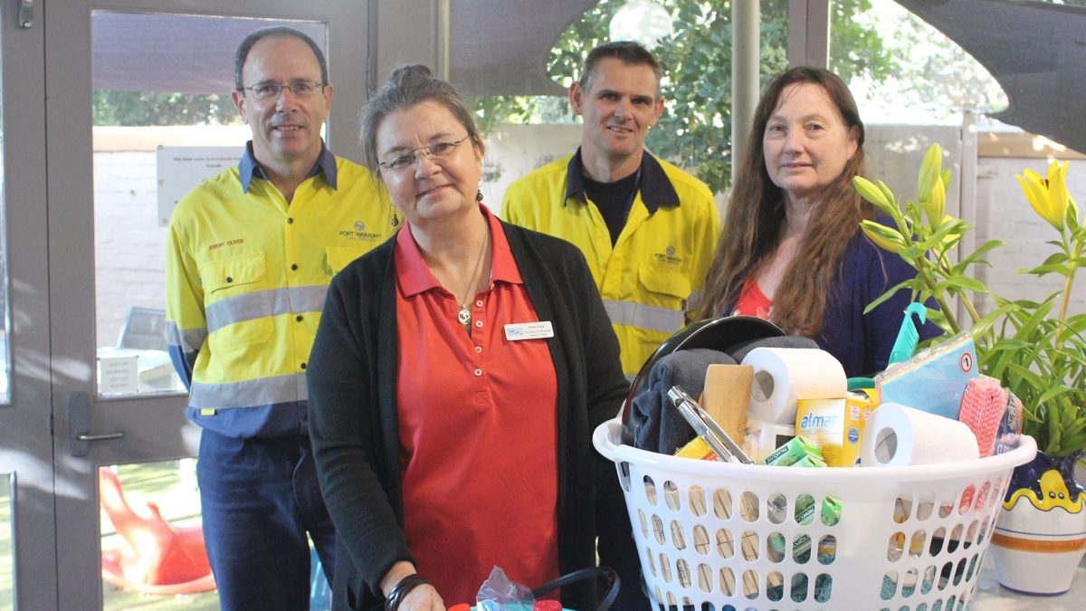 Jenny's Place volunteers with donations
