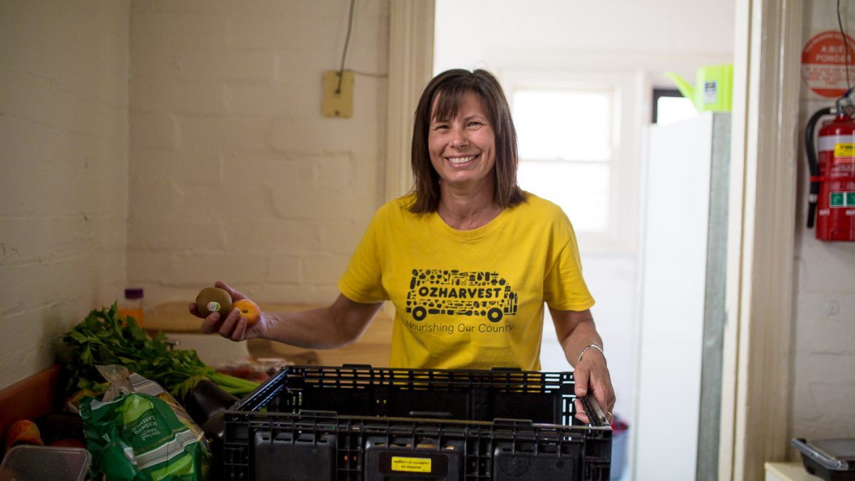 OzHarvest Volunteer sorting food donations
