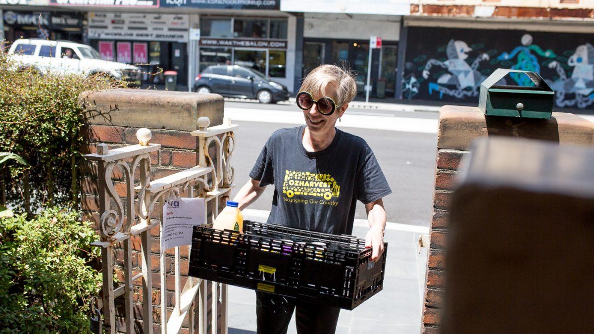 OzHarvest Volunteer delivering food